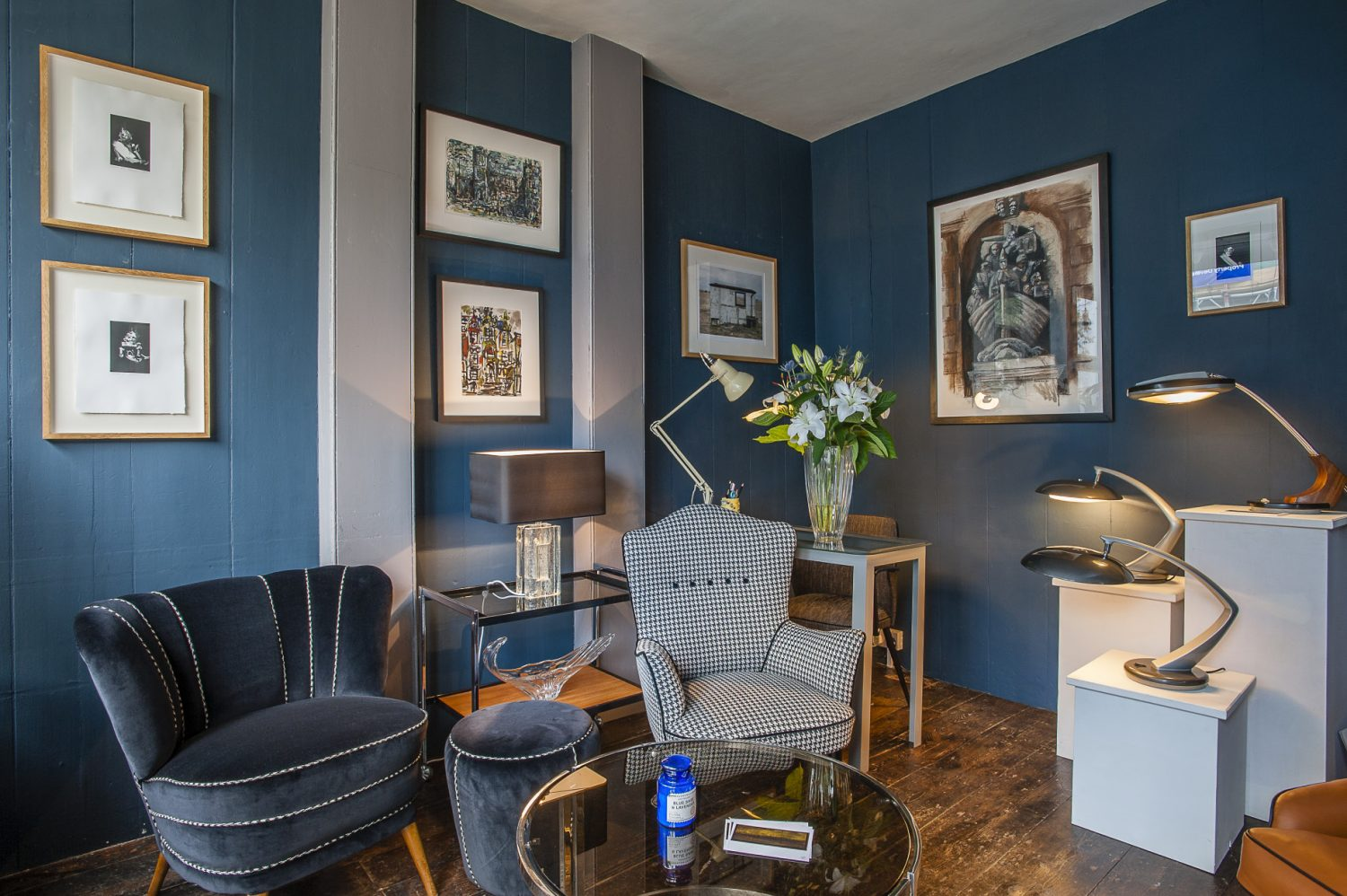 Christine sources mid-20th century chairs and has them restored and re-upholstered for her shop The Kula. The walls are painted in Hague Blue by Farrow & Ball. The 1960s Ice Glass lamp was designed by Uno Westerberg