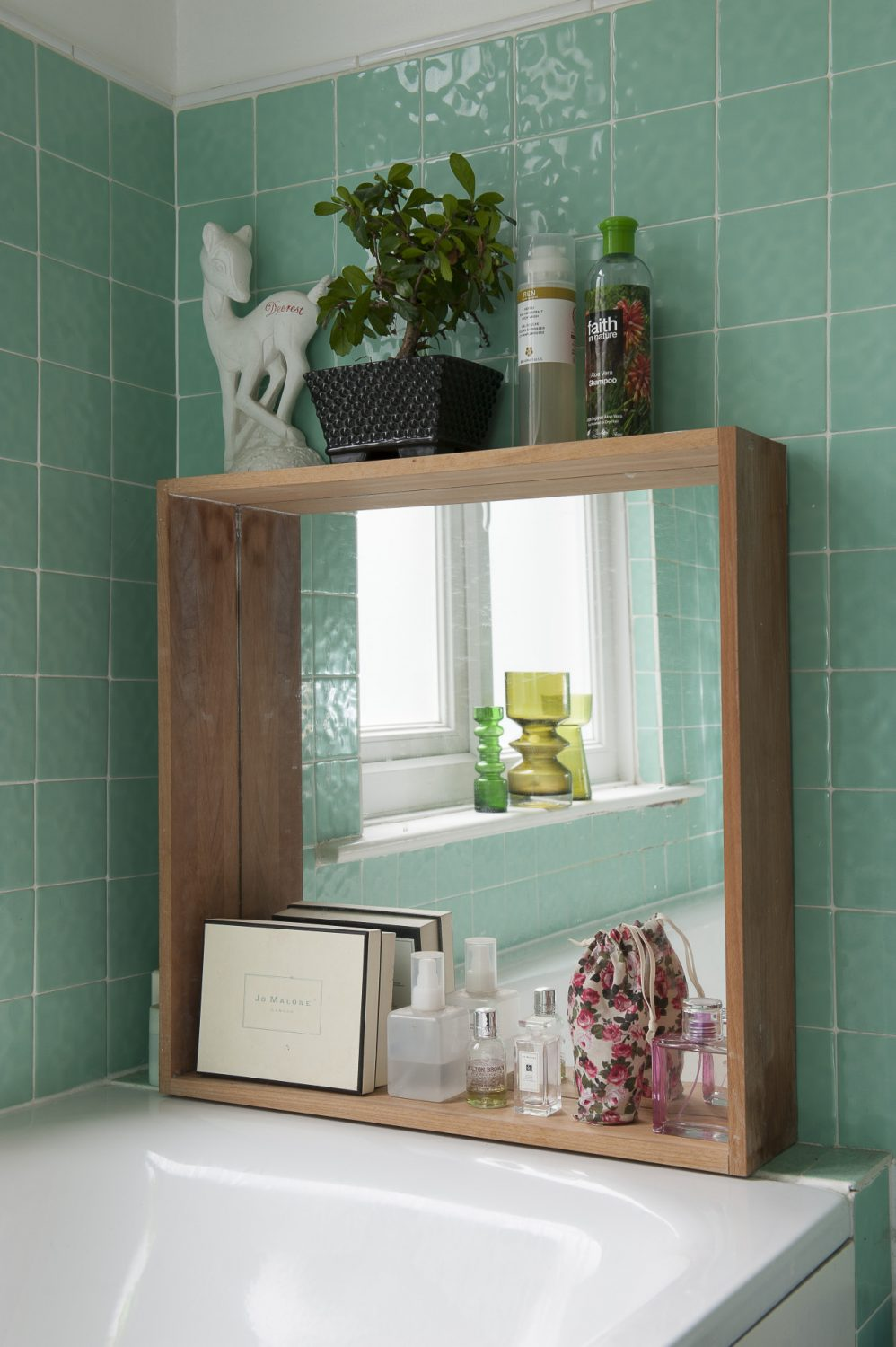 Mint green tiles give the bathroom a crisp, fresh feel