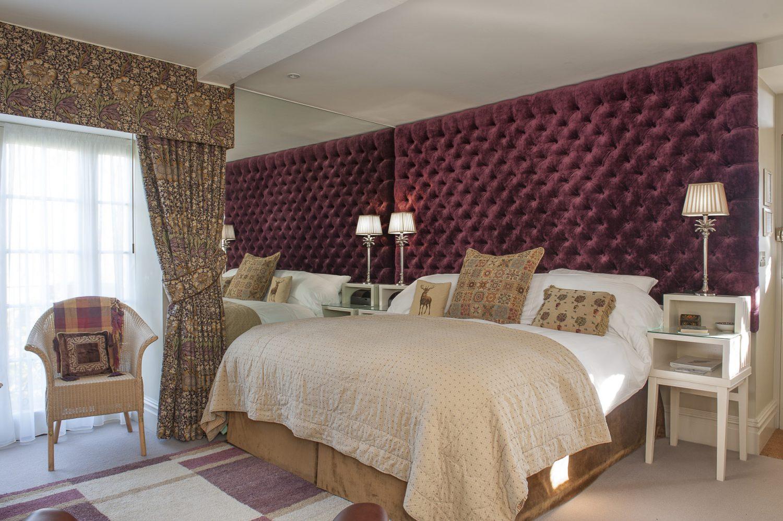 Bloomsbury features a lavish Designers Guild purple velvet headboard and William Morris curtains