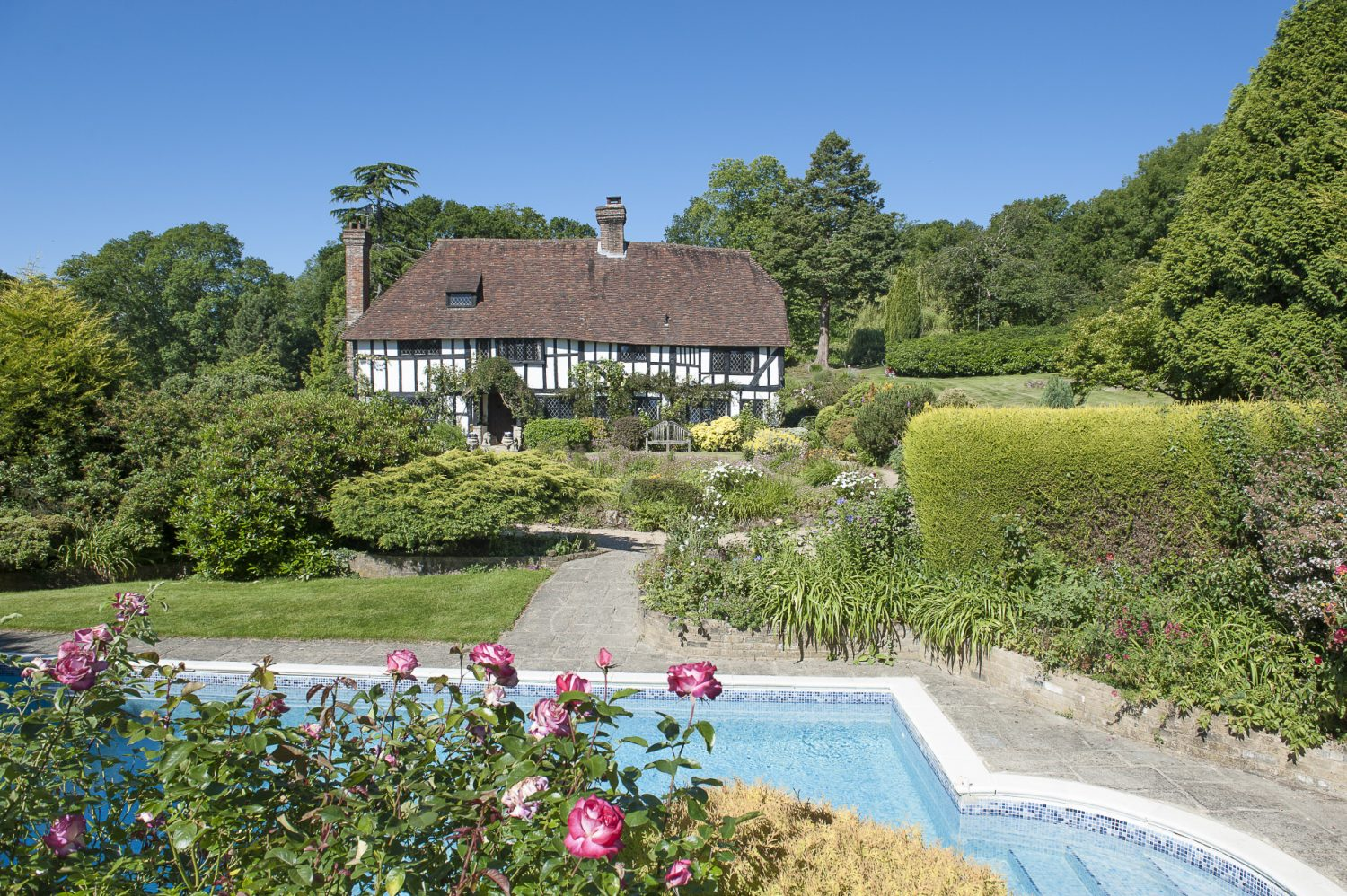 Pennybridge has 55 rolling acres of grass pasture but the house is set in a beautiful, blowsy cottage garden looking across the lawns to the swimming pool