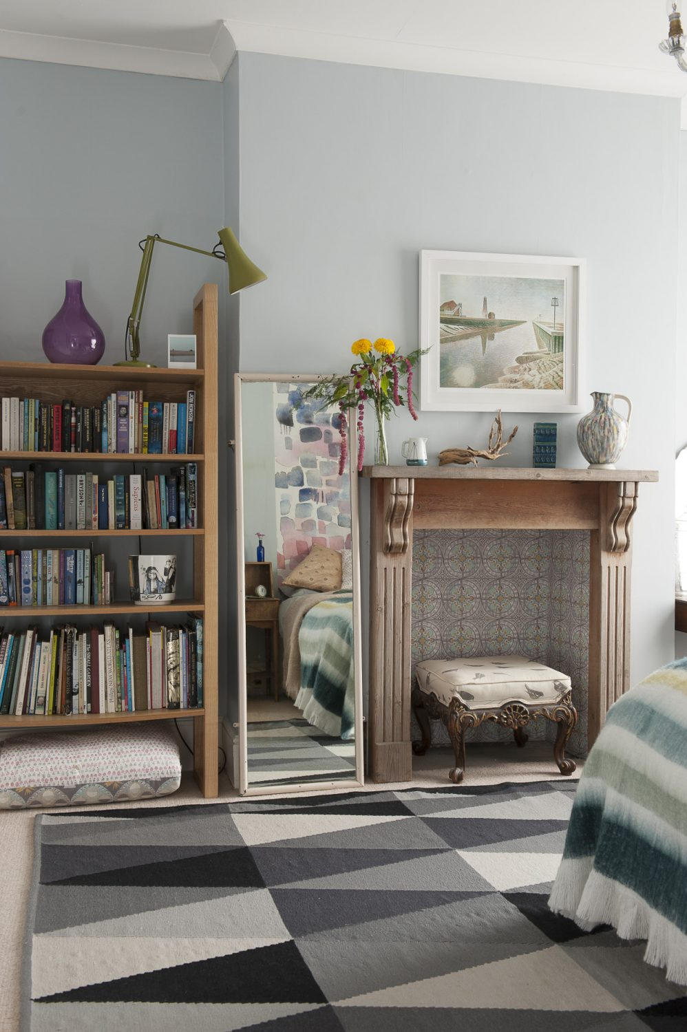 The print over the fireplace is by Eric Ravilious, a birthday present from husband Jonny. The footstool belonged to Louise's grandparents and has been recovered in her fabric Dot-to-Dot. The jug vase is from Snoopers Paradise in Brighton
