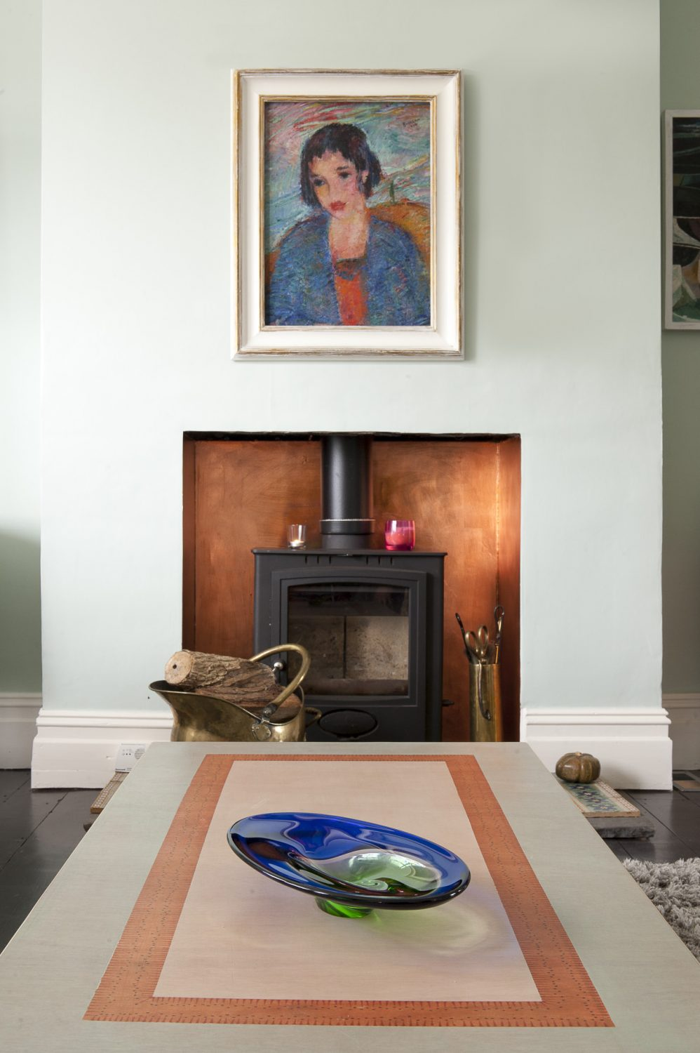 The painting over the woodburner is by Oskar Barblain