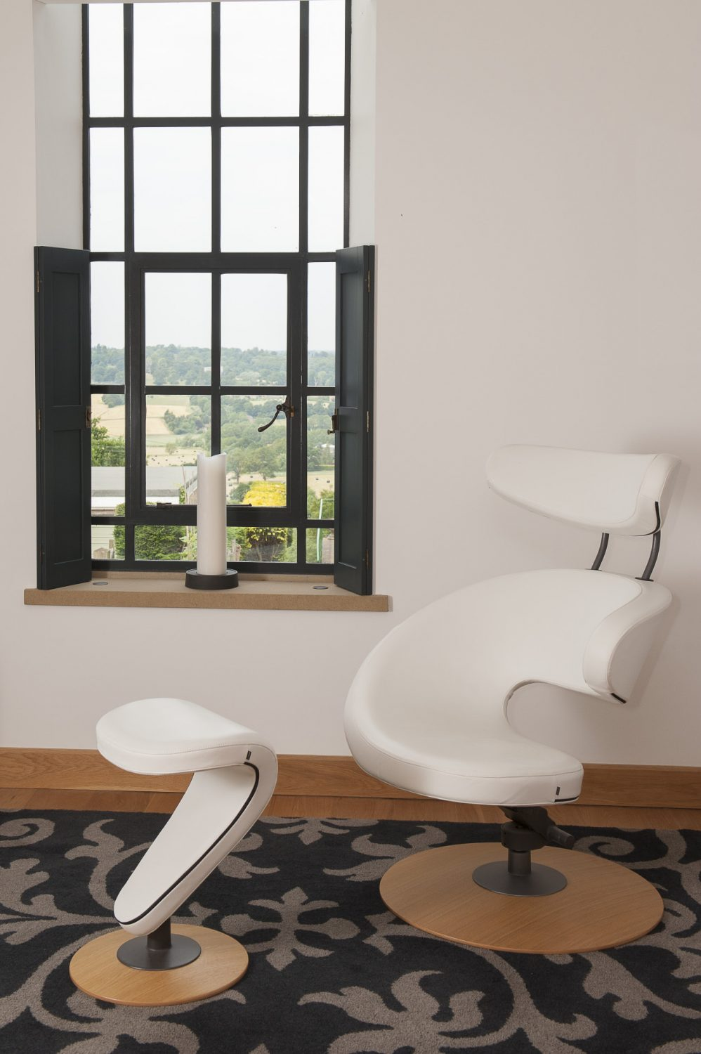 A truly superb white leather Varier 'Orange Peel' chair where the couple can take it in turns to relax and enjoy the stunning westerly view down from the top of Goudhurst hill