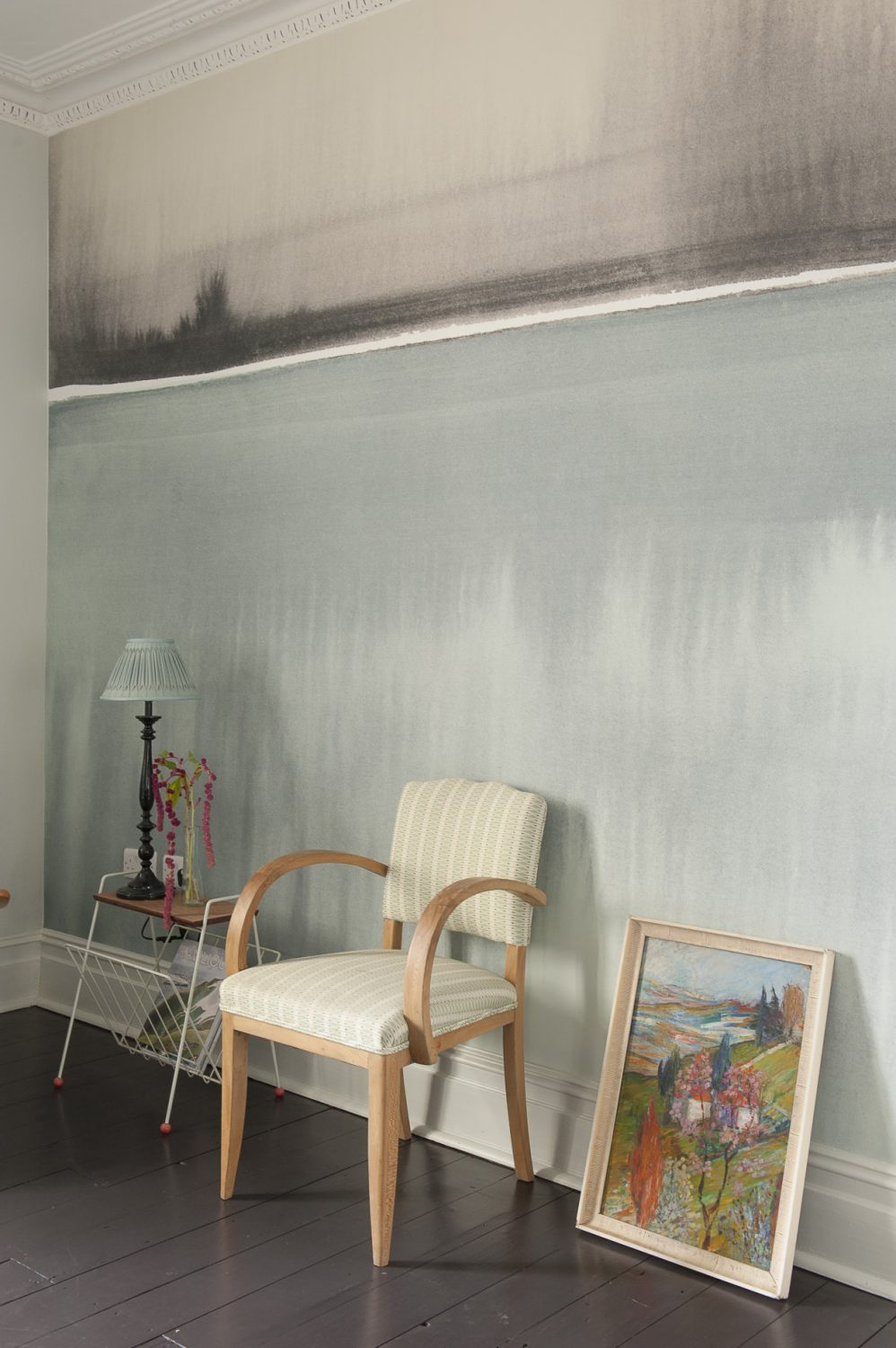 The wallpaper is from Louise's Murals collection, this one is called Still Lake. The painting propped against the wall is by Oskar Barblain