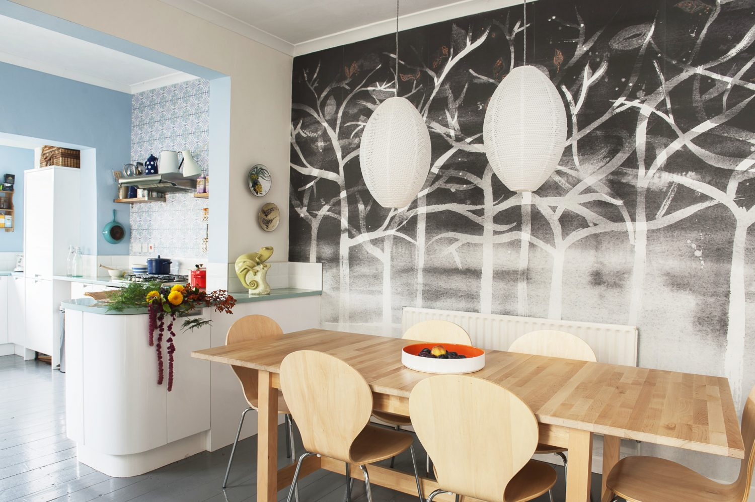 The wall behind the dining table is papered with Louise's design 'Midnight' from her Forest range. The dining chairs were a Dunelm find, £5 each
