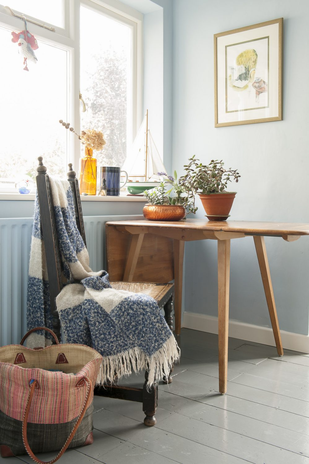 The Ercol table in the kitchen is from Glass Etc in Rye. The shawl was a gift. The watercolour of Louise's grandparents' cat Bumper was painted by her grandmother, Granny Jean