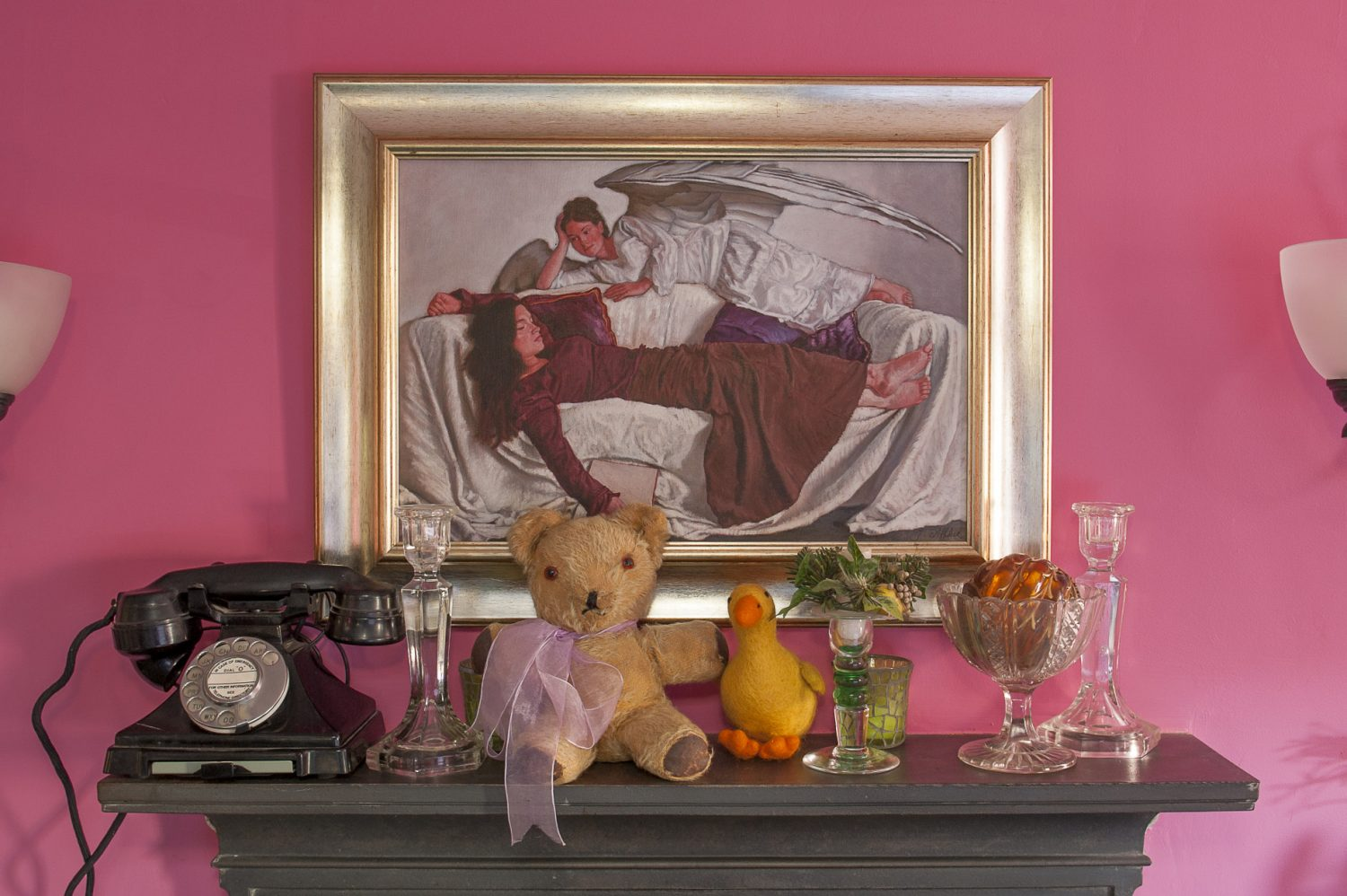 The teddy on the bedroom mantlepiece was given to Eve when she was three days old. The painting is 'An Angel Watches Over Me' by John Afflick