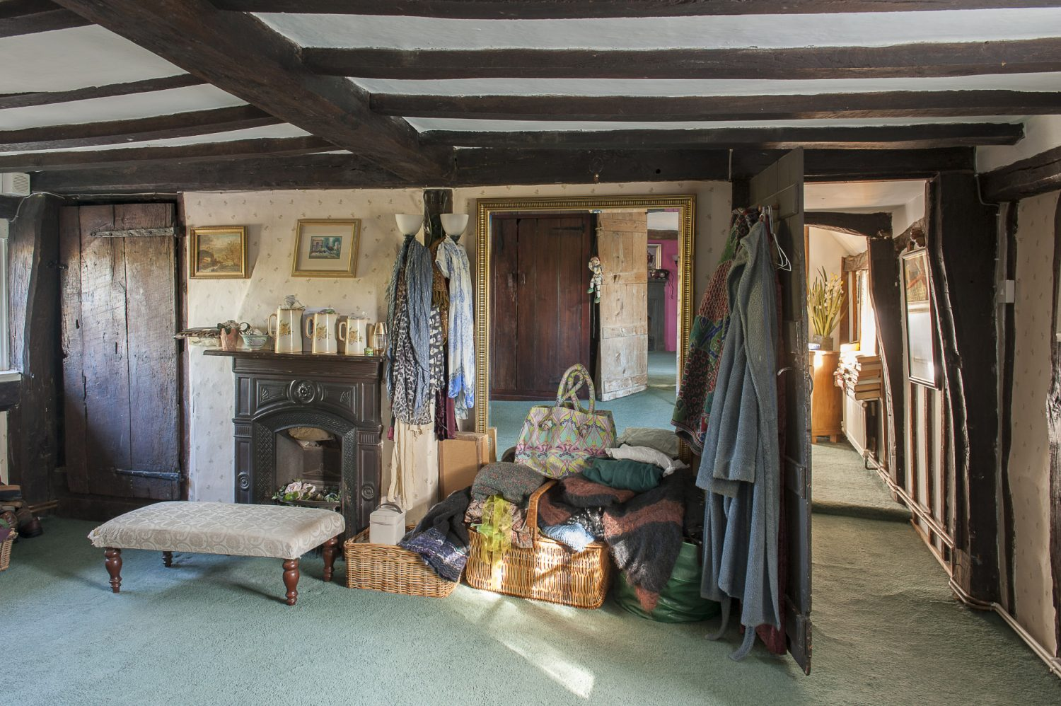 Upstairs, Tim and Eve use the large space outside the bedroom as a dressing room