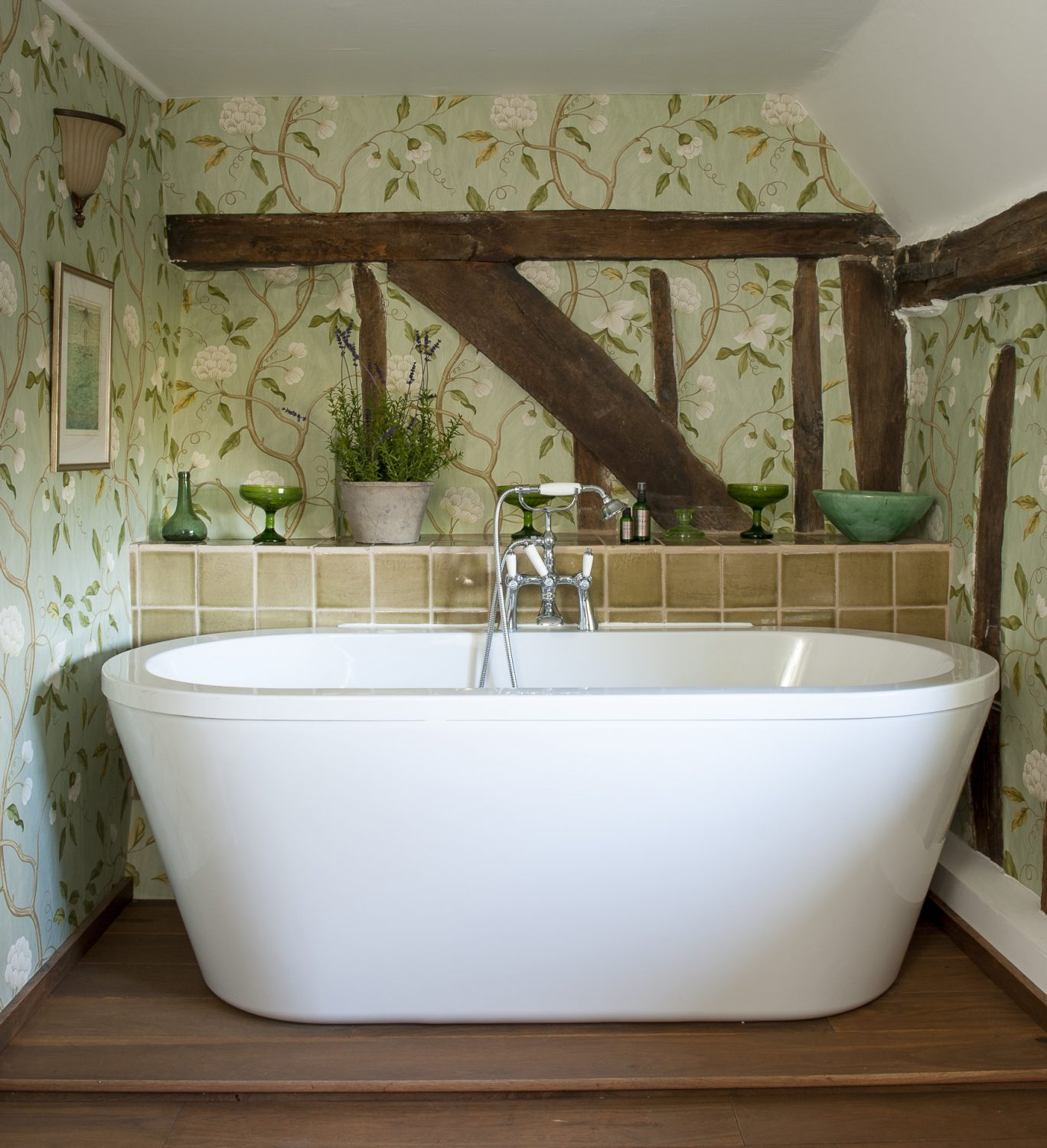 The bathroom was recently refurbished by their builder friend, Steve Moss. Eve chose the wallpaper, by Colefax & Fowler, because it looks as though it has been painted onto the wall