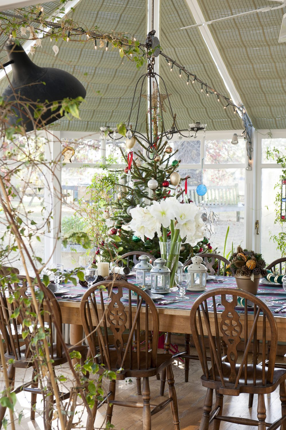 The plant-filled conservatory was added about 18 years ago and is where big family feasts are eaten