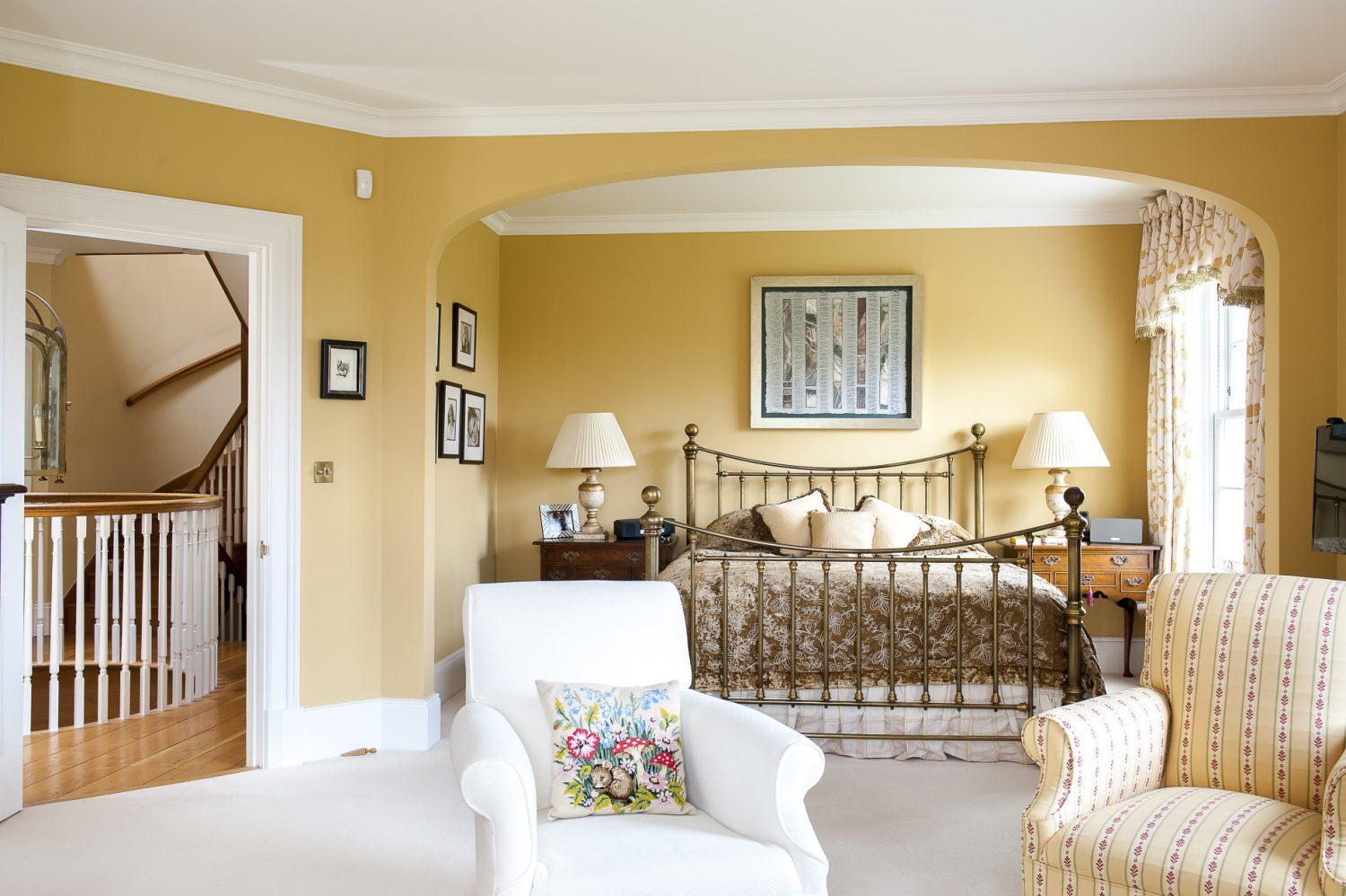 The master bedroom suite, with comfy seating area at one end, has magnificent views from every window. An adjoining door leads to the ultimate en suite – or rather, to a staircase up to a huge, top-floor bathroom