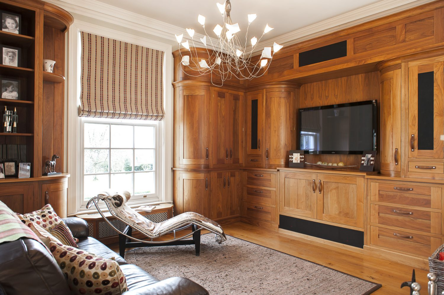 The Carson family decided to move away from a traditional Georgian style for the family room, opting for a more contemporary look, complemented by this striking Corbusier chaise longue and 'birds' nest' light fitting. The fitted cupboards also hide a fridge – for the ultimate luxury of chilled drinks on hand