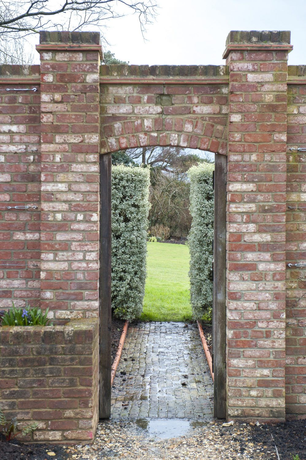 The family has built a wonderful, traditional walled garden, including brick paths, flower and vegetable beds, and a large, modern greenhouse