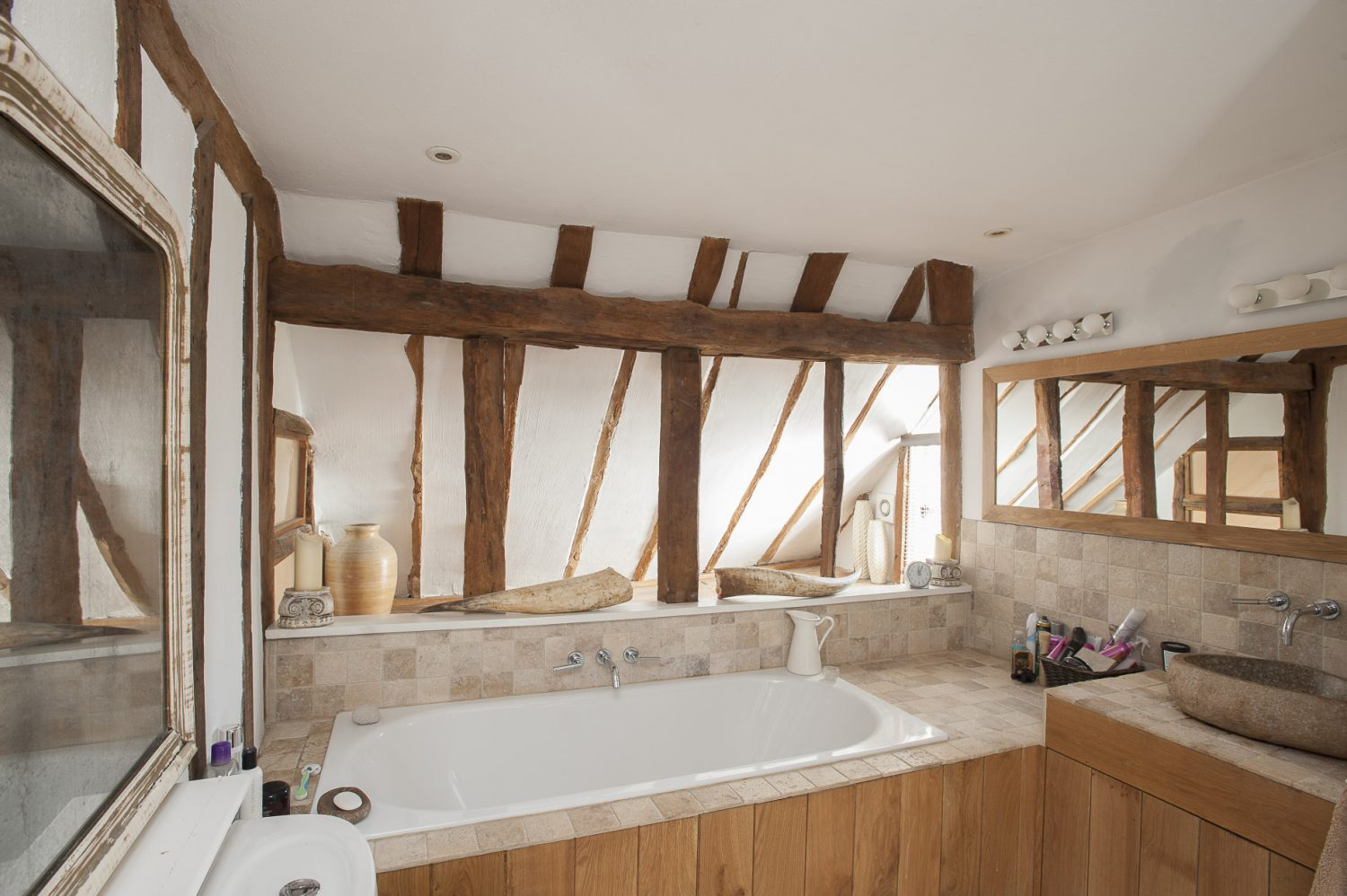 The family bathroom is a balance of contemporary and period – plenty of timbers and complementary woodwork but also items like a great Fired Earth hand basin carved from a single piece of stone