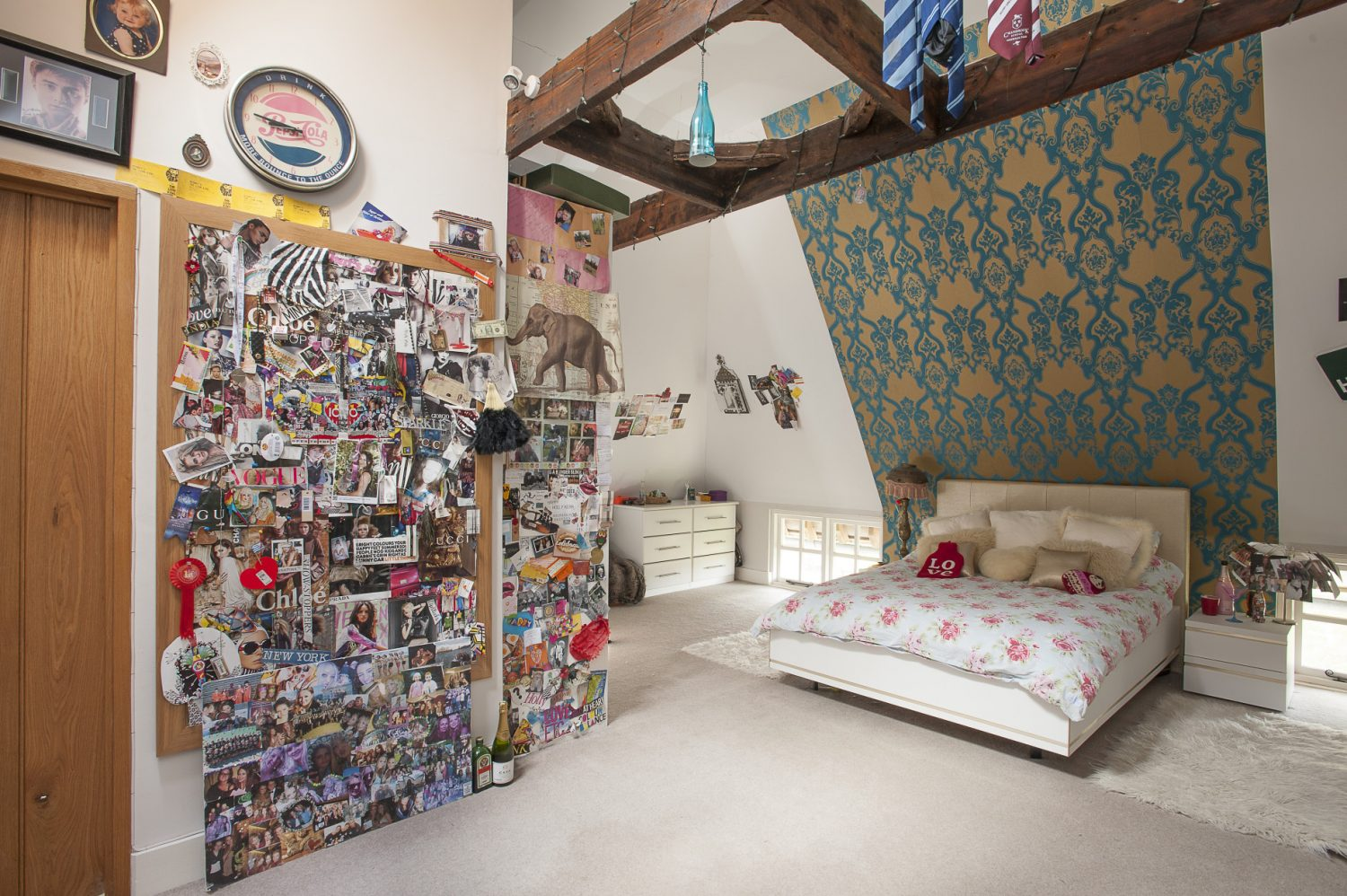 Lorraine has papered the vaulted wall in daughter Holly's room with Designers Guild Bergamasque Turquoise from Bell House