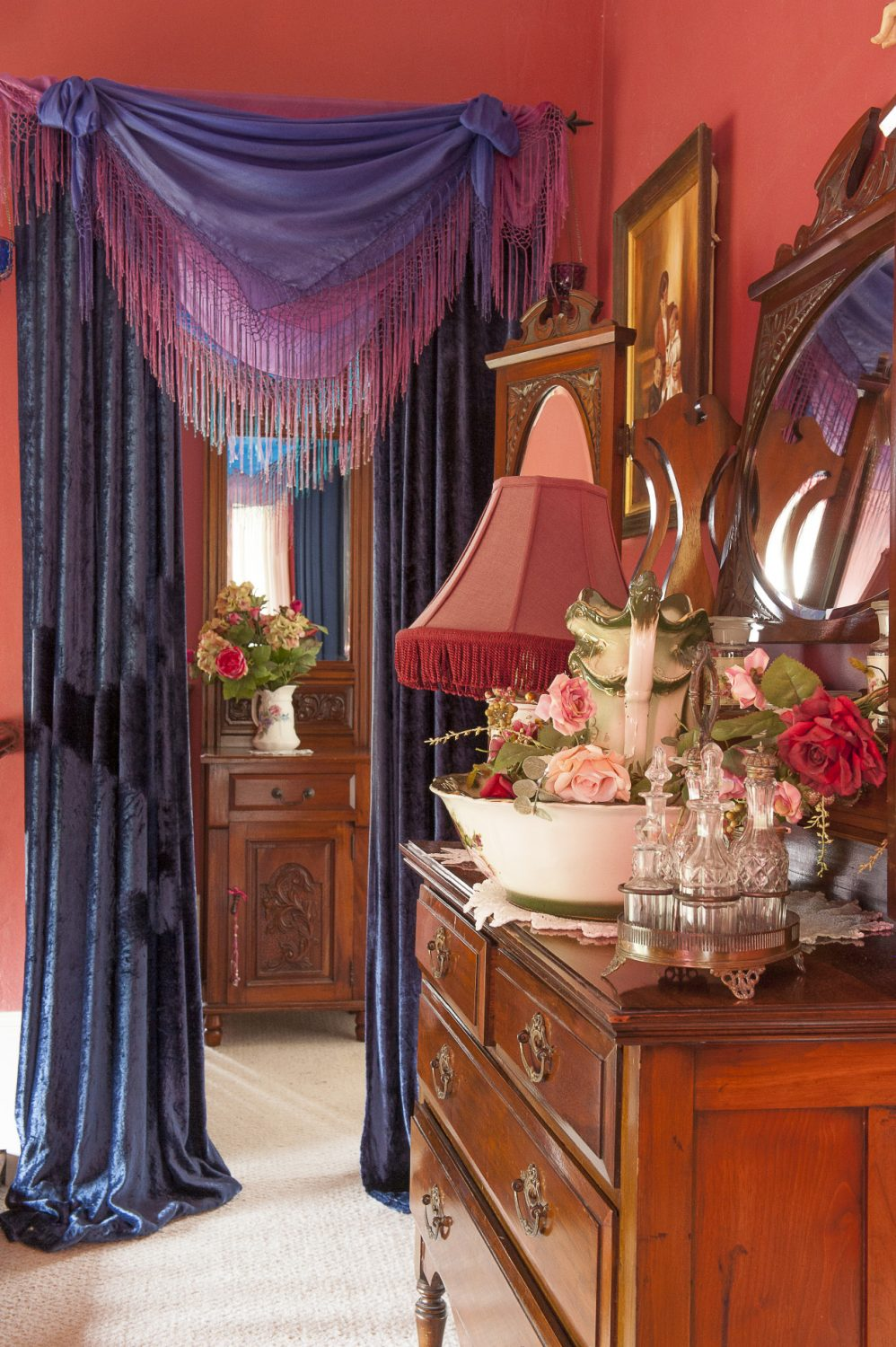 Upstairs, tasseled scarves and velvet curtains veil the entrance to the master bedroom