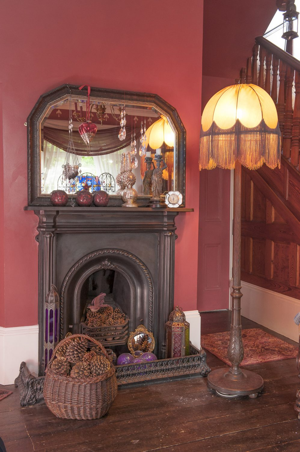 The dining room fireplace is surrounded by oriental and Moroccan influences, the rich tones highlighted by glowing Venetian glass