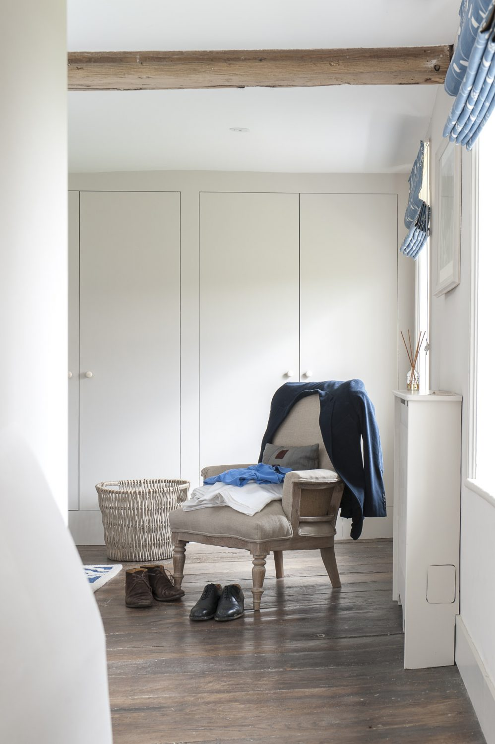 Sleek fitted cupboards offer masses of storage in the master bedroom