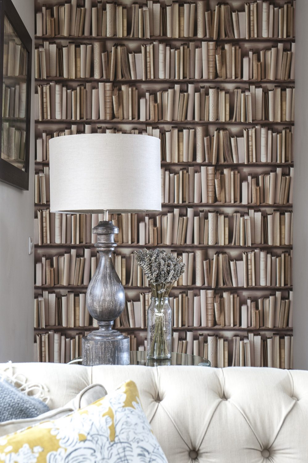 Trompe l'oeil wallpaper depicting a bookcase hides a secret door which leads through to a less formal living room and children's play area