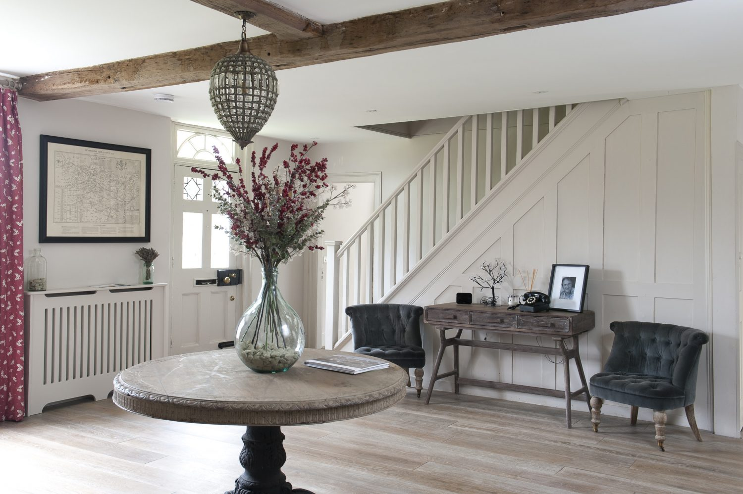 Ben and Perrine found their hall table in an antique shop in the Cotswolds. The teardrop wire and glass lampshade above it is from Not On The High Street and much of the furniture is from Graham & Green, whose 'look' complements the unpretentious but comfortable interior of Tanner House
