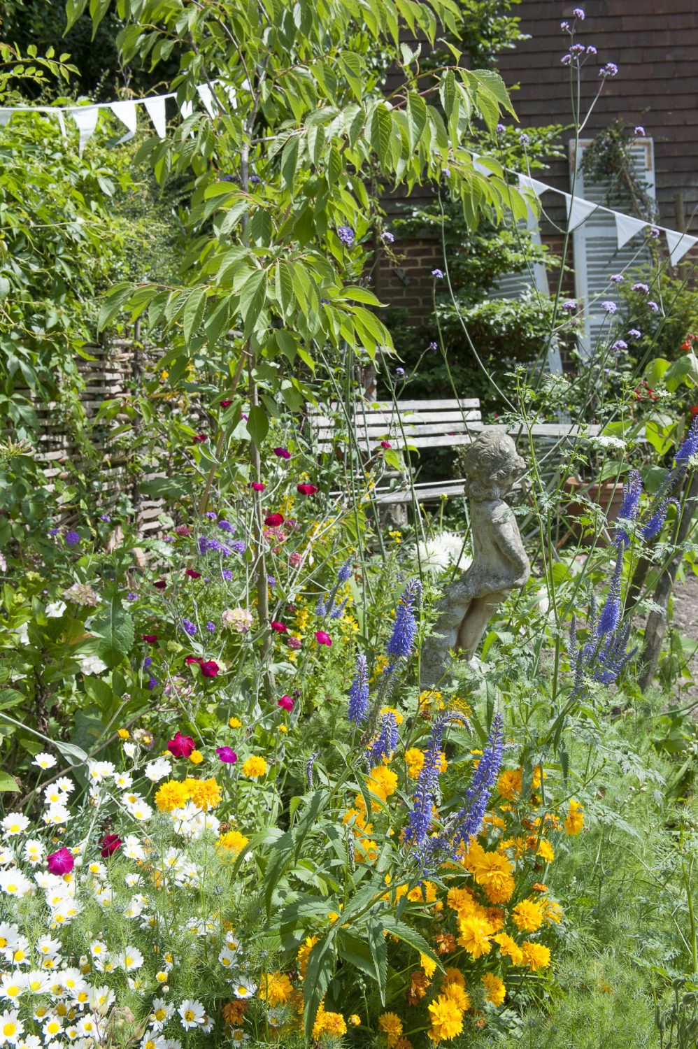 The garden now home to vibrant flower beds and swathes of bunting