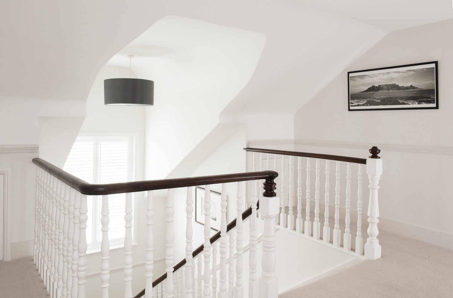 A wide staircase sweeps up to the top floor, the domain of daughters Alice and Ellie
