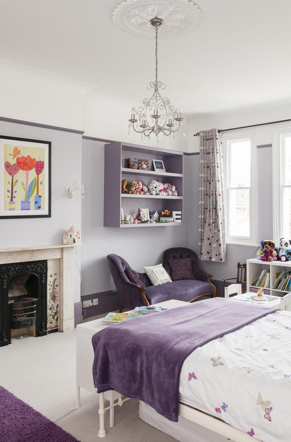 Daughter Emma's room used to be the original master bedroom and is now a spacious retreat decorated in hues of purple