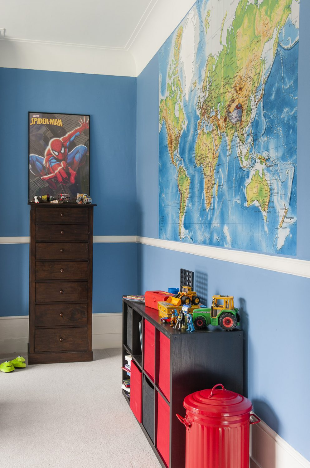 Son James' very blue room features a giant map of the world papered onto one wall
