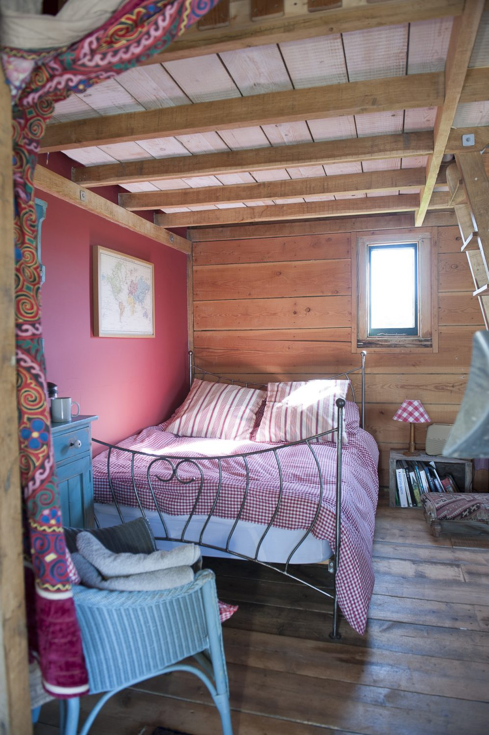 A double bed in the lakeside shack looks over the fishing pond and paddocks containing geese, sheep and, in the far corner, pigs. There is departure from Caroline's muted colour scheme in the shack, which features warm tones on the walls and furnishings