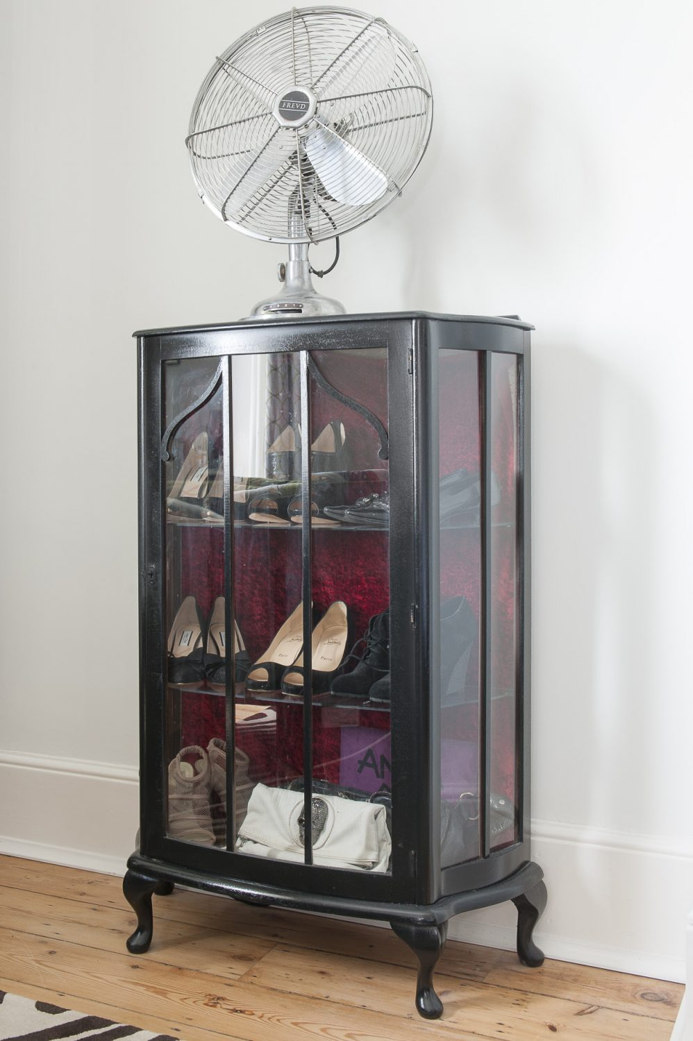 A glazed cabinet is home to her collection of shoes