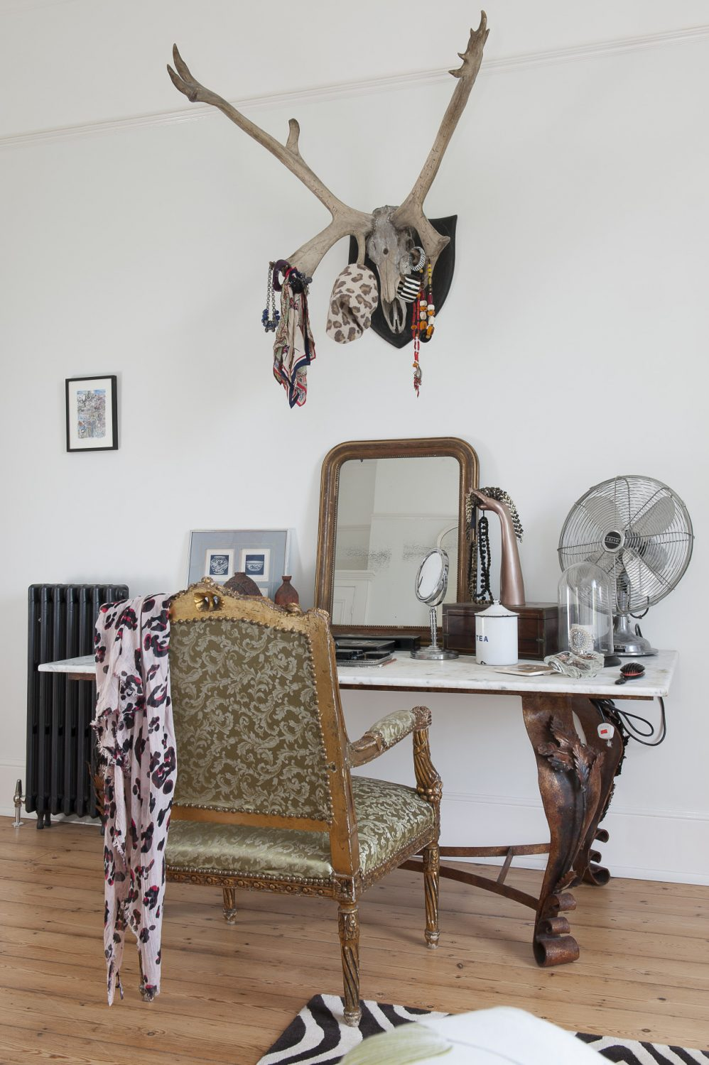 Mounted on the wall above her dressing table, antlers provide the perfect place for Louise to hang scarves and jewellery