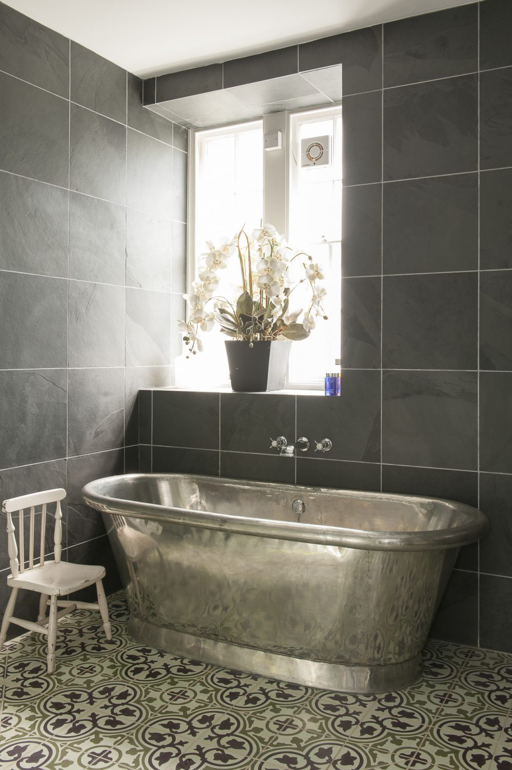 Centrepiece of the en suite bathroom is a glorious William Holland brass bath