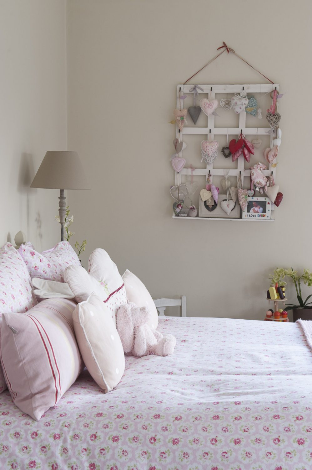 Victoria and David's daughter's room is furnished with a carved Laura Ashley bed, dressing table and an antique armoire, and accessorised with Cath Kidston rosebud bedlinen, a Kate Forman floral print fabric for the blinds and vintage painted tables and chairs