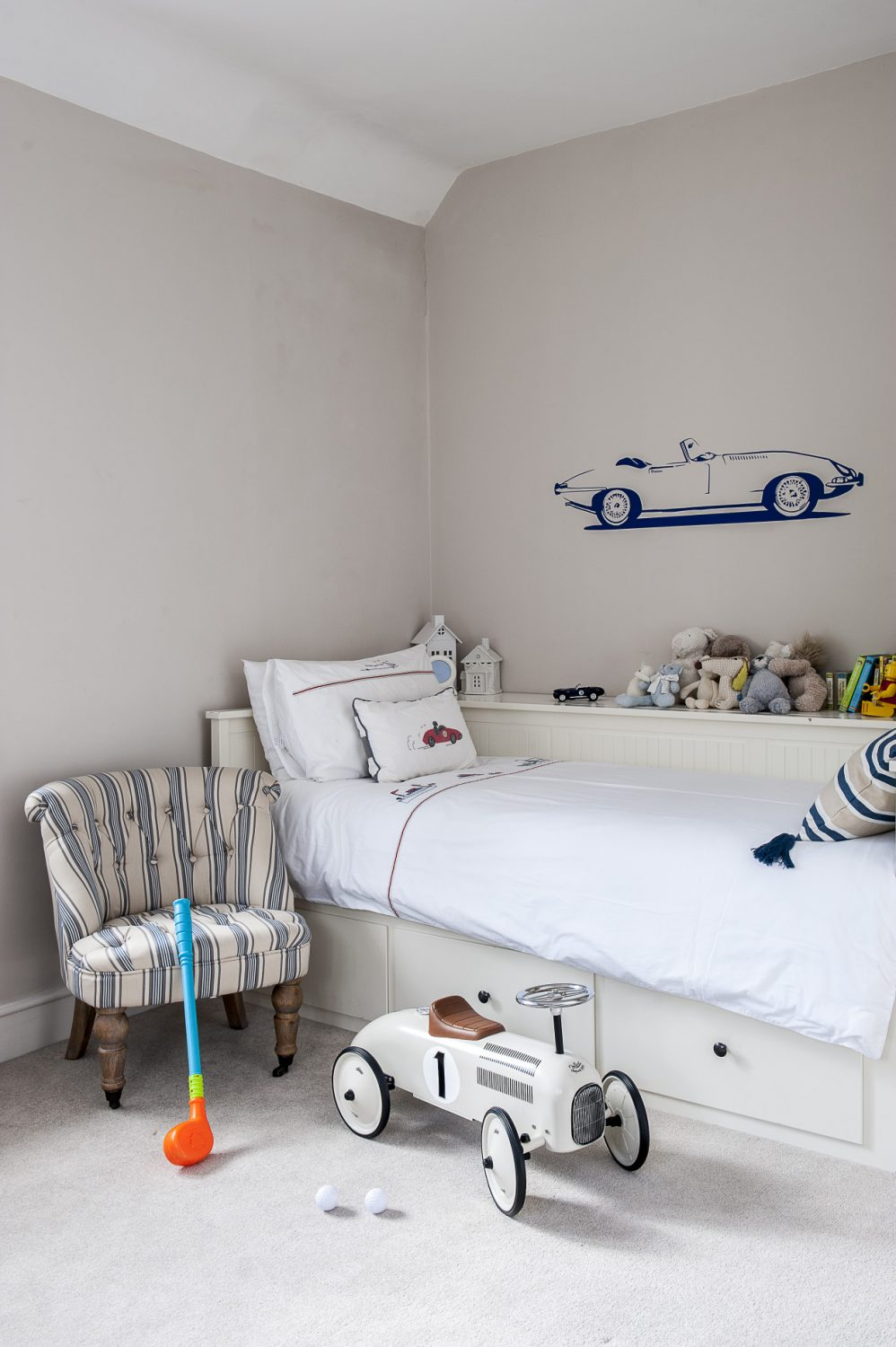 The couple's son's room is themed with his current favourites, including racing cars and sailing boats