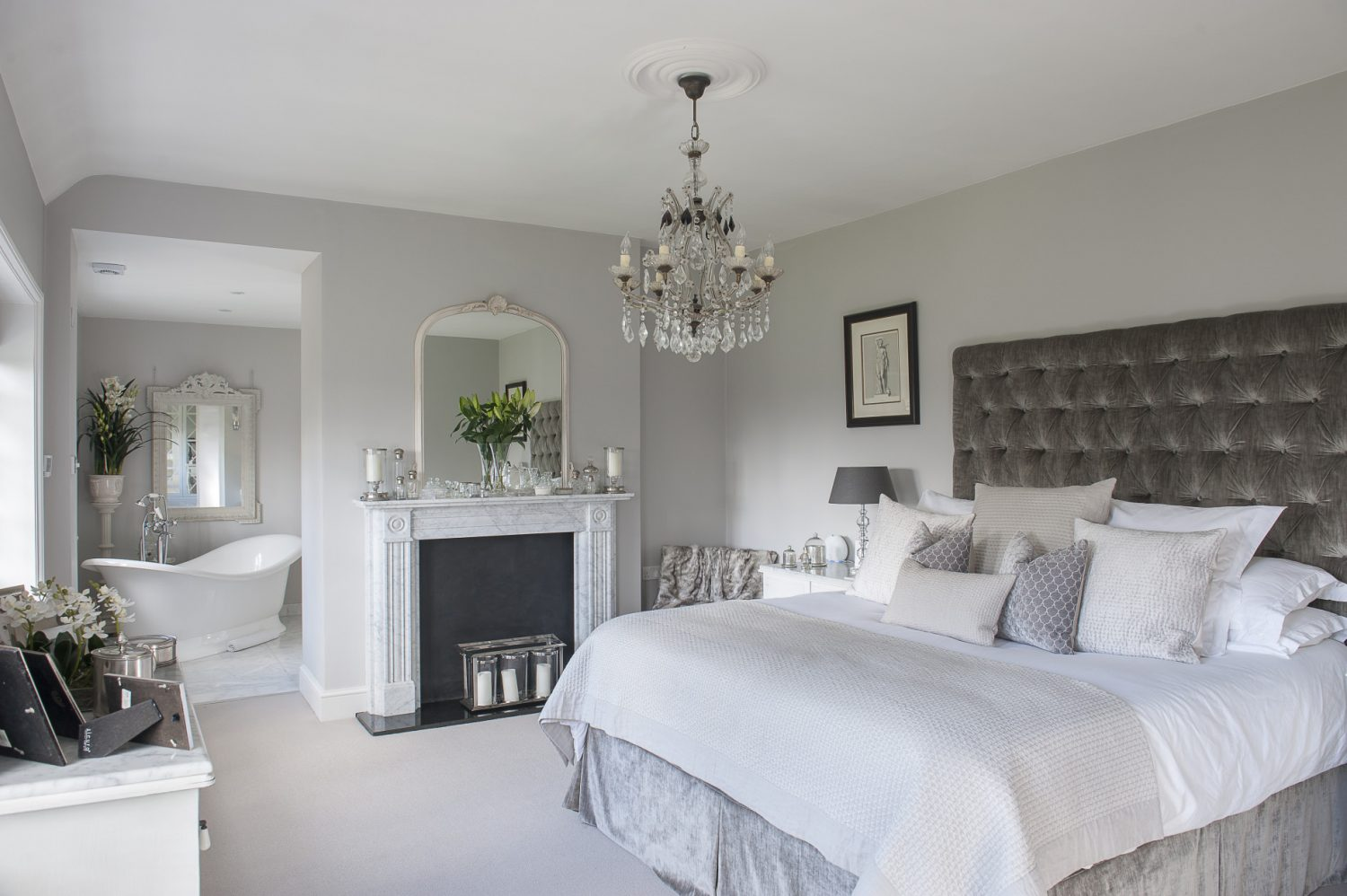 The master suite, painted in Little Greene's French Grey comprises three rooms that feel wonderfully luxurious; the bedroom, dressing room and bathroom
