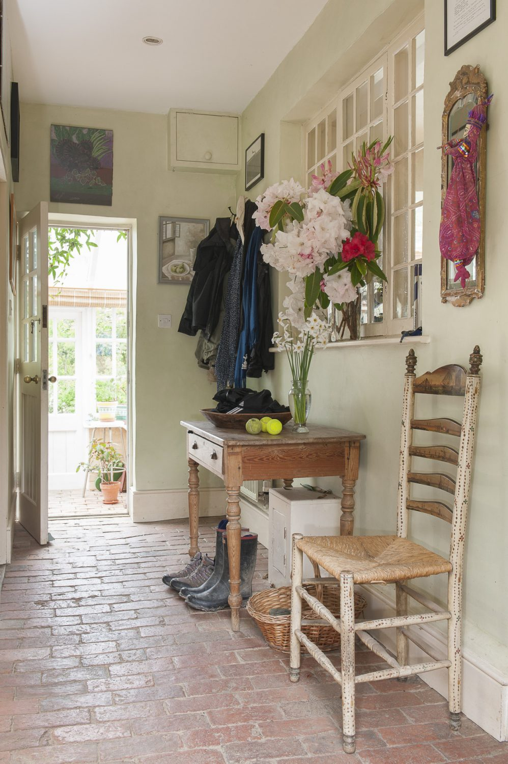 The hallway leads straight through into an airy conservatory