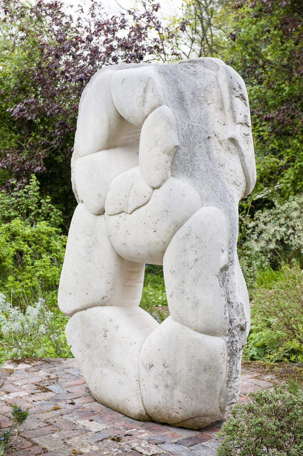 A large Portland stone sculpture by local sculptor Jeremy Nelson is the focal point of the rose garden overlooked by the kitchen