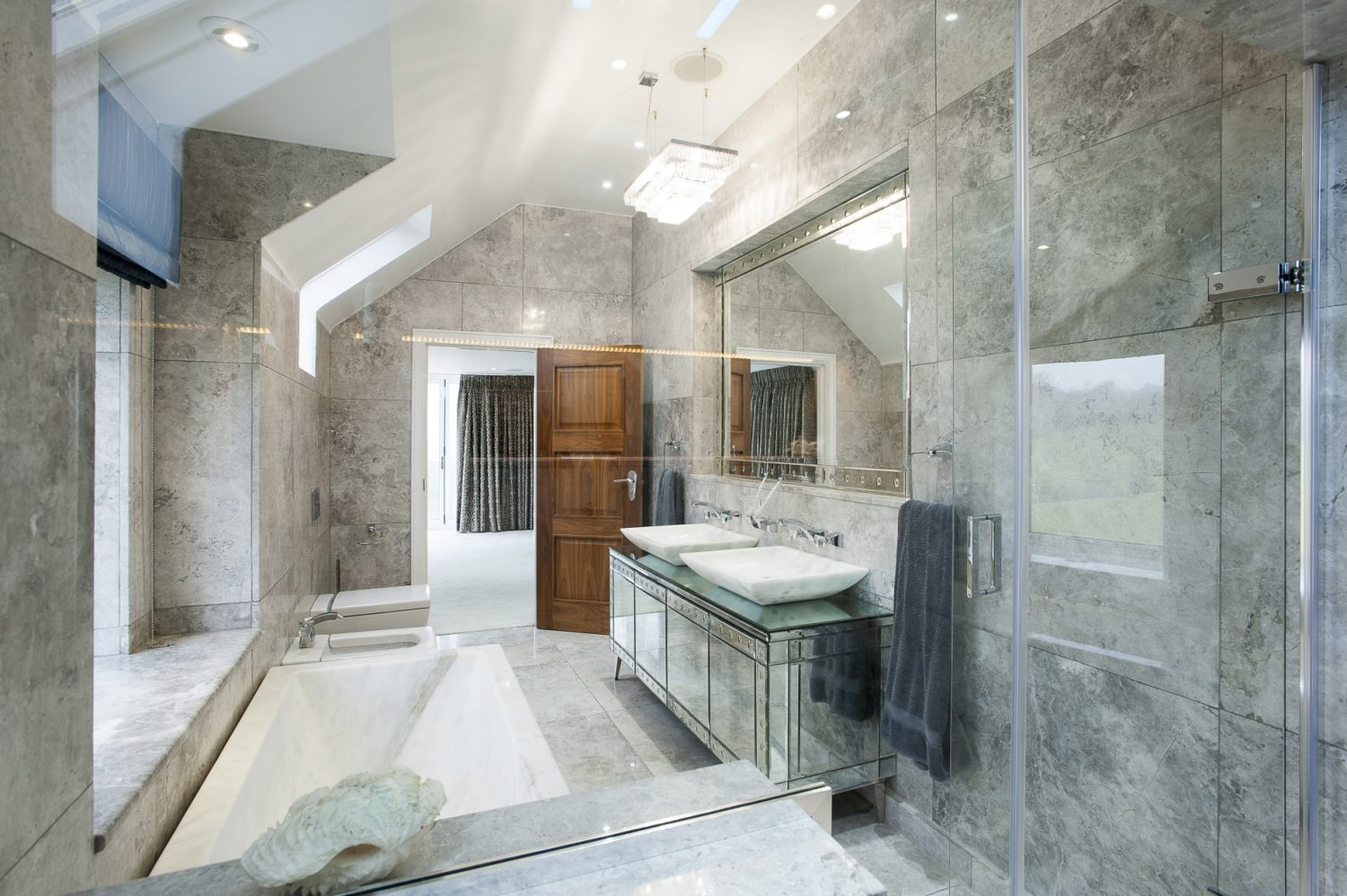 Weighing three tonnes, manoeuvring the bath into the master bathroom was a nightmare. Barry Hutson hit on a brilliant solution to carefully slide it off its massive trolley onto a block of ice that then slowly melted, lowering it into exactly the right position