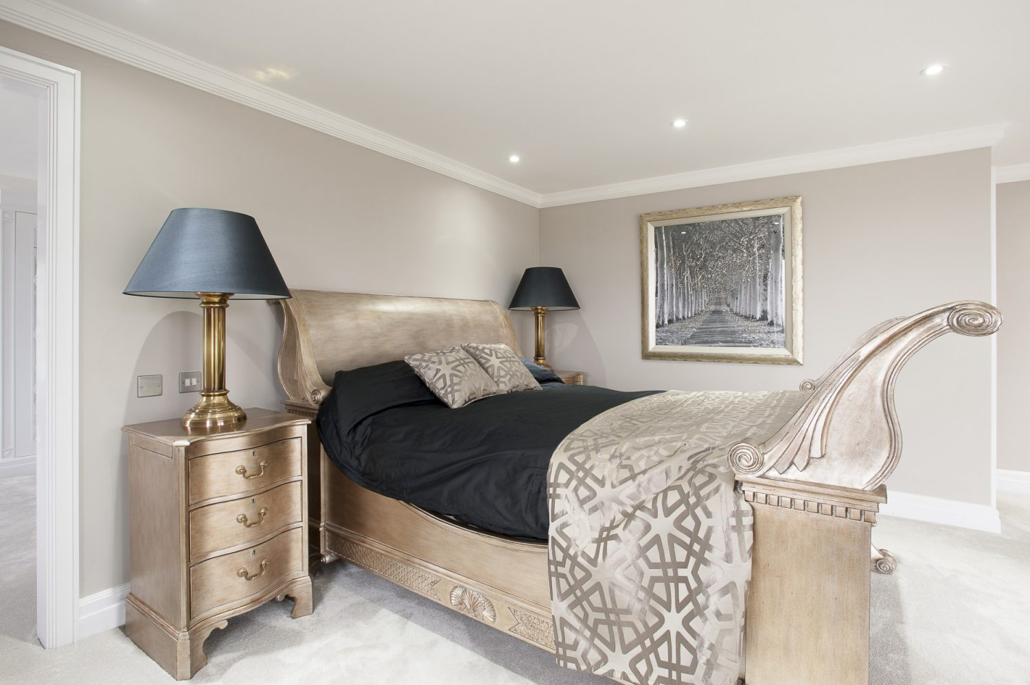 Richard and Katie's master suite has a warm hint of gold in the dramatic bed and dressing table, both from And So to Bed in Tunbridge Wells