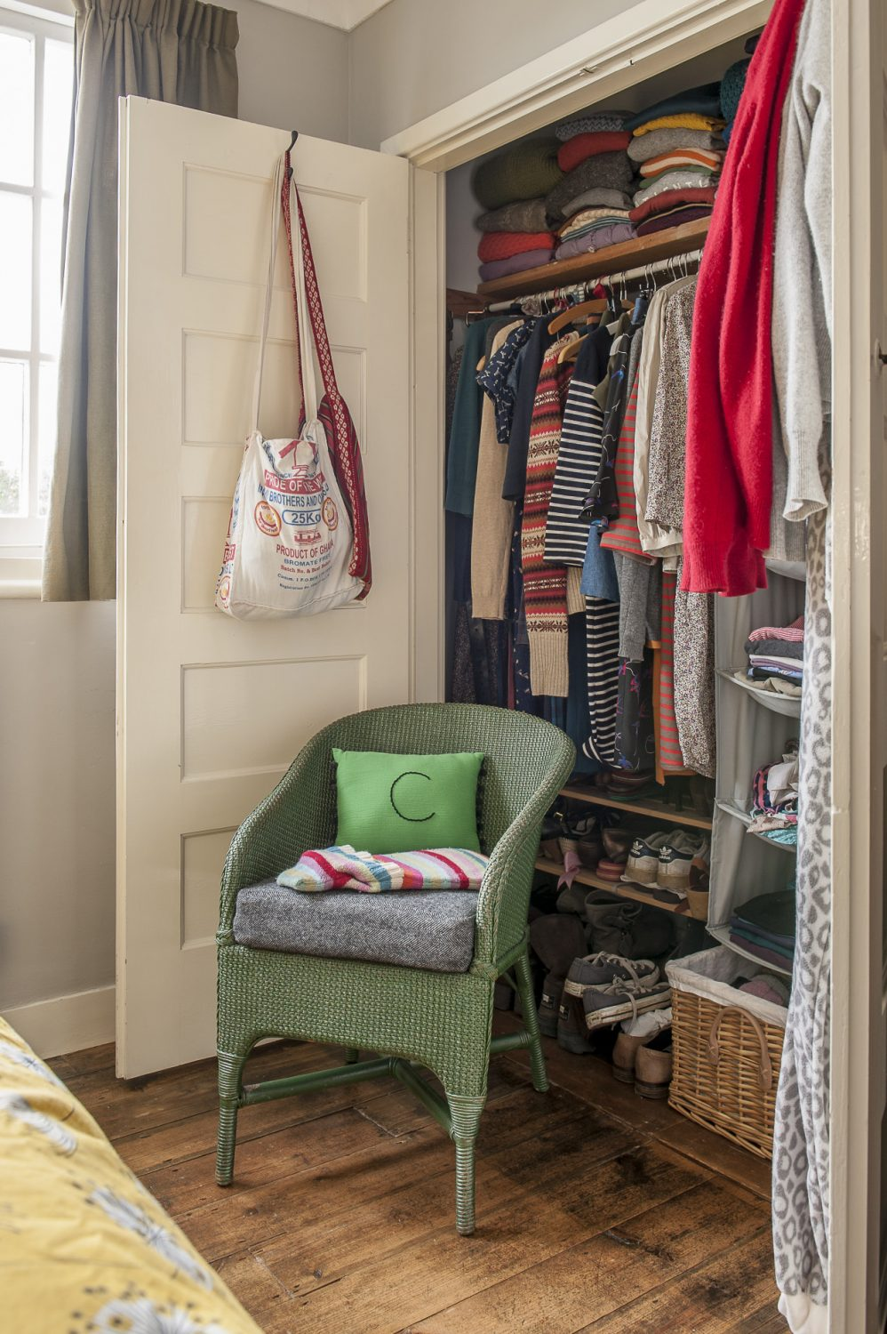 Chunky knits and bright fabrics hint at Claire's love of sewing and making, while a Lloyd Loom chair looks perfectly at home