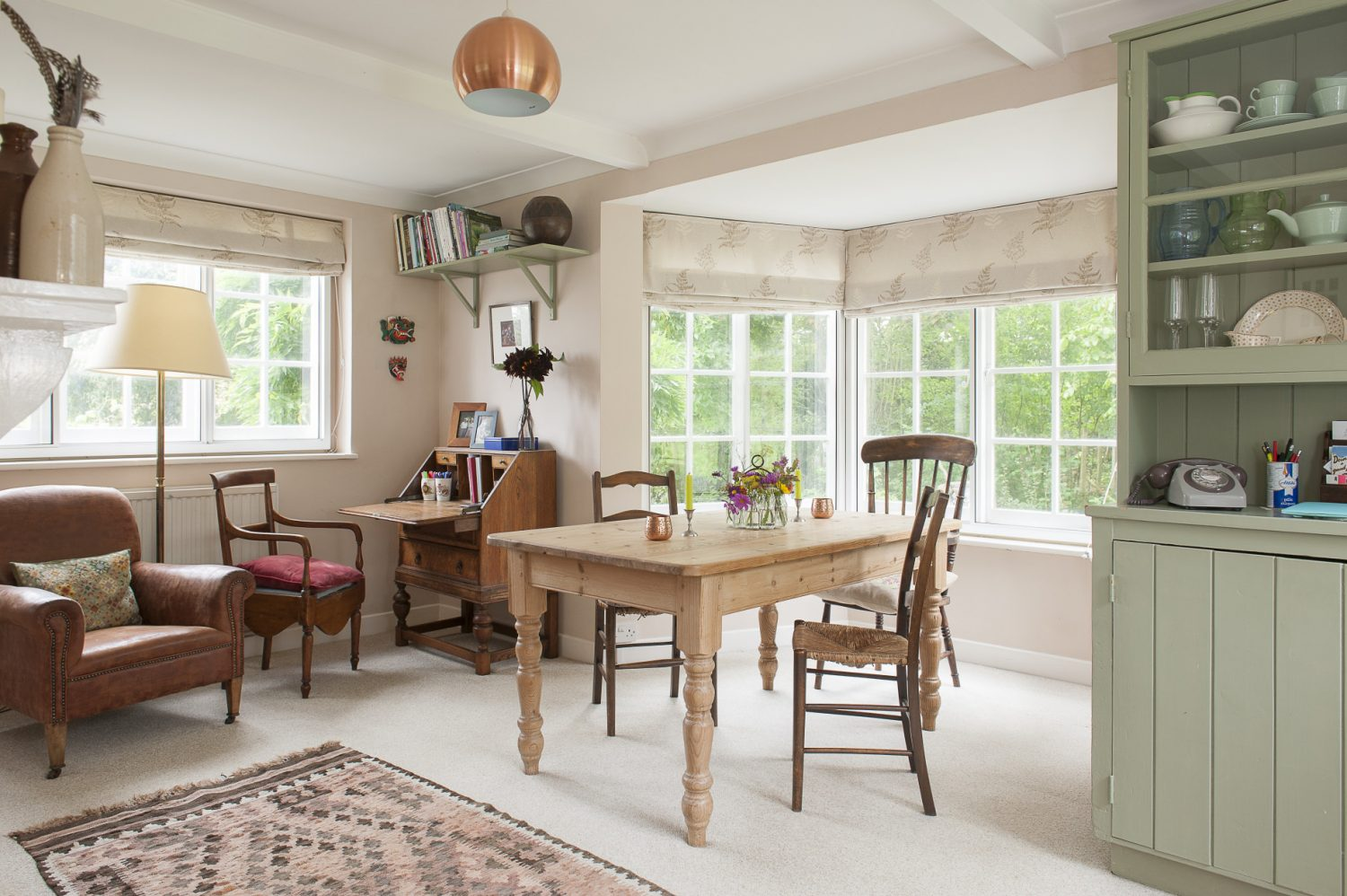 A rustic farmhouse table overlooking the kitchen garden is the perfect place to sit down and enjoy a meal made from home-grown vegetables