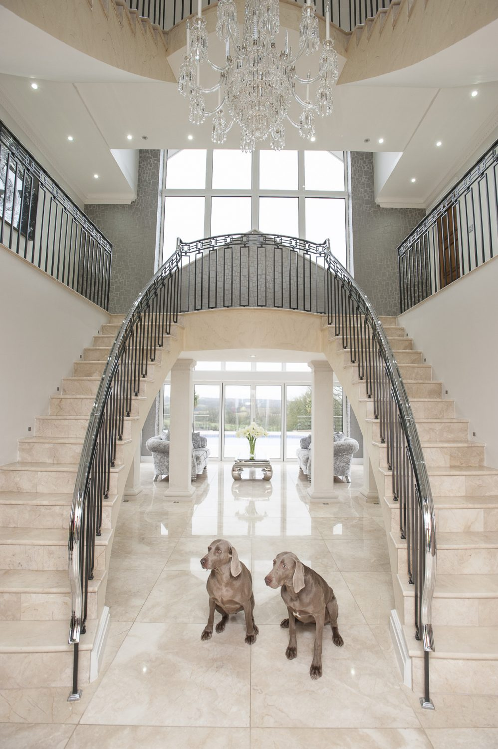 The chrome-on-brass Art Deco metalwork banister is a one-off designed exclusively for the house by Burvills Ornamental Metalwork in Surrey. Suspended in its centre is a glittering four-and-a-half foot high, 14-stone Wilkinson chandelier...
