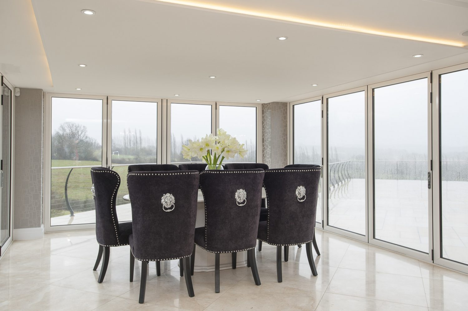 The couple have created a spacious kitchen, dining and living area which enjoys beautiful views into the valley below