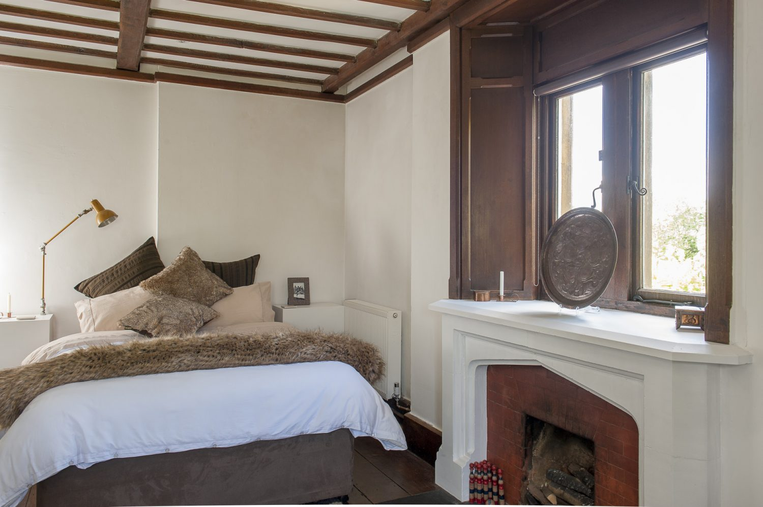 The beamed bedroom in the B&B suite had been at some point remodelled in Arts and Crafts style and Dan has run with this adding a further dimension with touches that again underline his creativity and talent as a designer