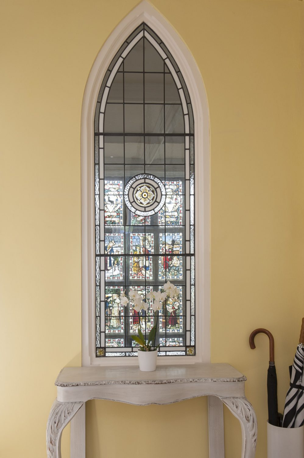 In the hallway is perhaps Dan's pièce de résistance, a superb Gothic stained glass window through which one has a superb view of the monumental window on the main staircase below