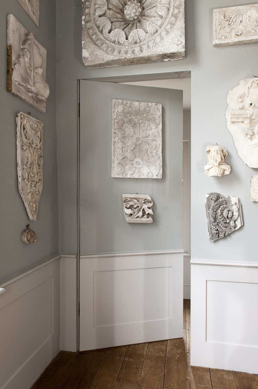 "Ornate plasterwork, as well as being dotted around the house, dominates the stairwell and landing area at the heart of the house: ""These samples would probably have been used by artists as references. It's a bit of an homage to Sir John Soane's house."""
