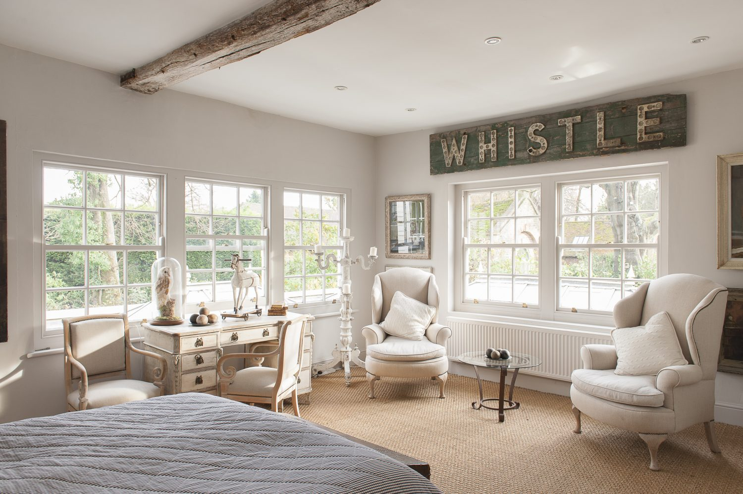 The 'Whistle' lettering on the wall, reminiscent of today's popular illuminated letters is in fact from an old railway station