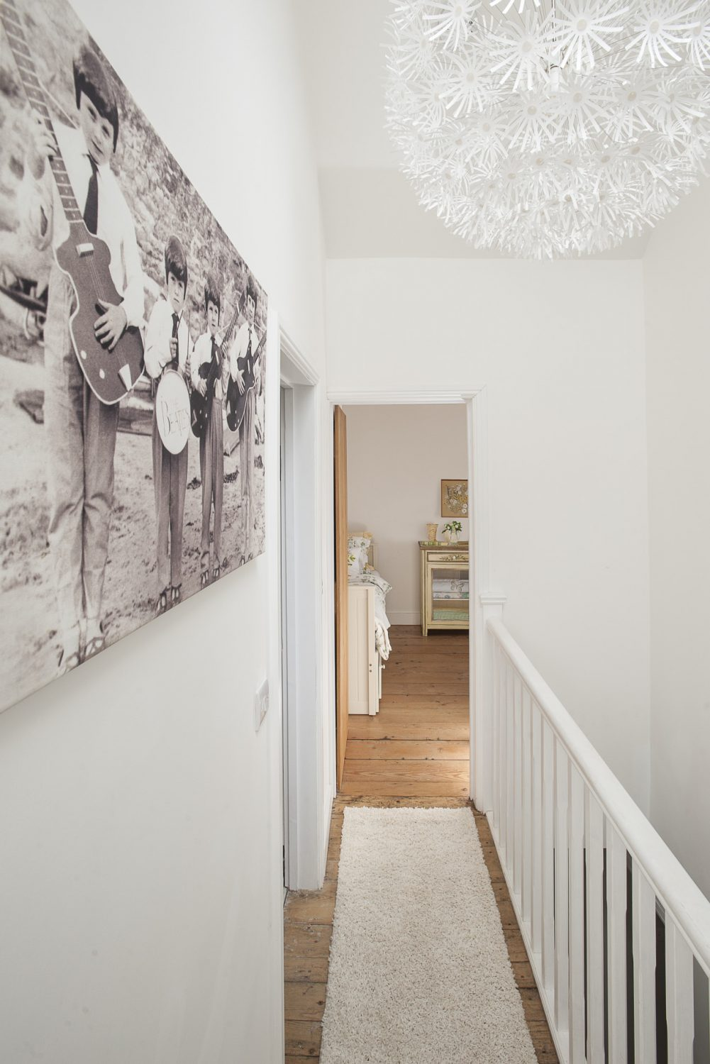 Up the stairs – painted very simply in white Annie Sloan furniture paint – you come to a wonderfully light and airy landing with raised and vaulted ceilings and home to another stunning mega light fitting – this one from Ikea