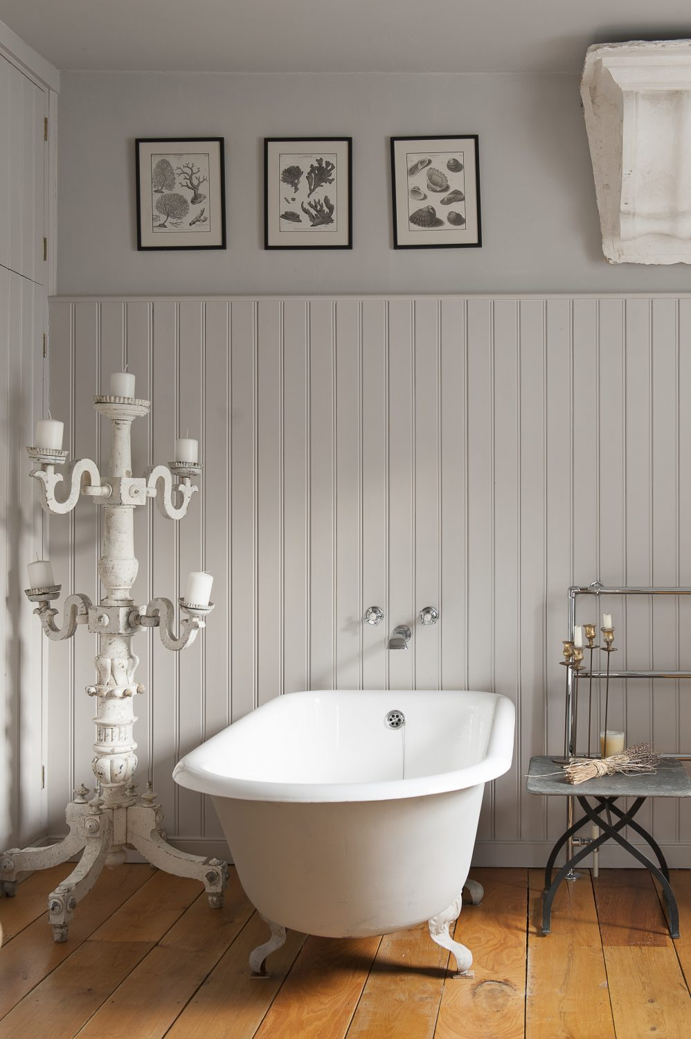 The en suite bathroom features a roll top bath and tongue and groove walls. The 'Whistle' sign on the wall is from an old railway station