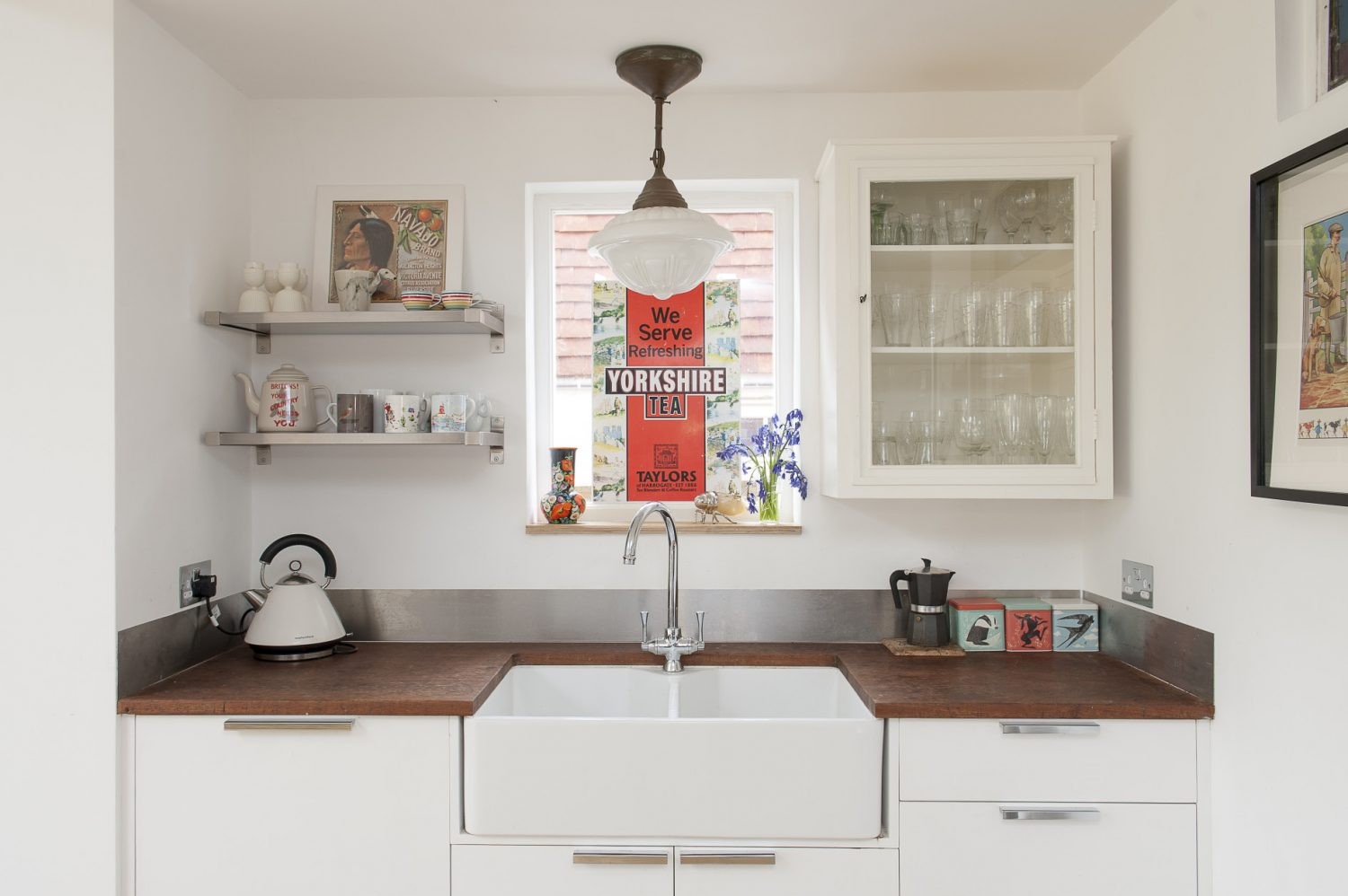 There is nothing twee about this stylish home which is filled with decorative items and mementos from around the world as well as practical touches such as a professional range cooker. This orderly sink area is across the room from the main food prep area, which has its own 'island' and boat-galley sink